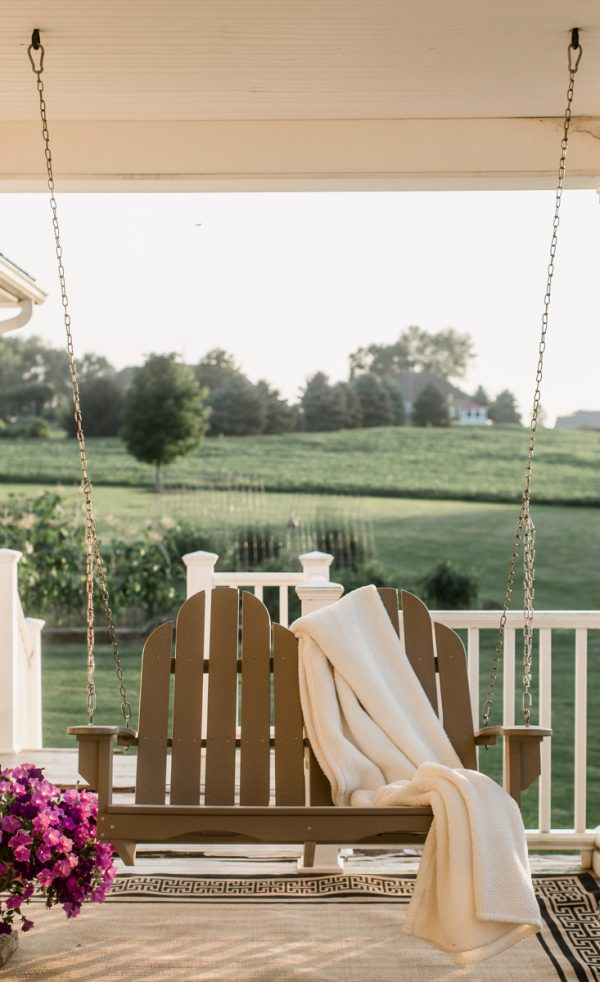 Hanging Wooden Porch Swing on the deck of a House
