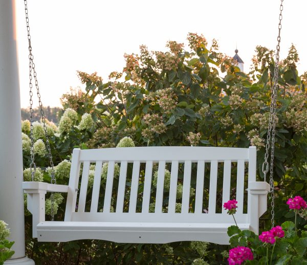 White Hanging Wooden Porch Swing Outdoors