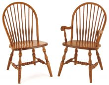 Light wooden round back chairs