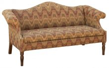 Upholstered Couch With Brown Patterned Fabric And Tall Arms