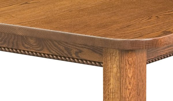 The corner of a wooden table
