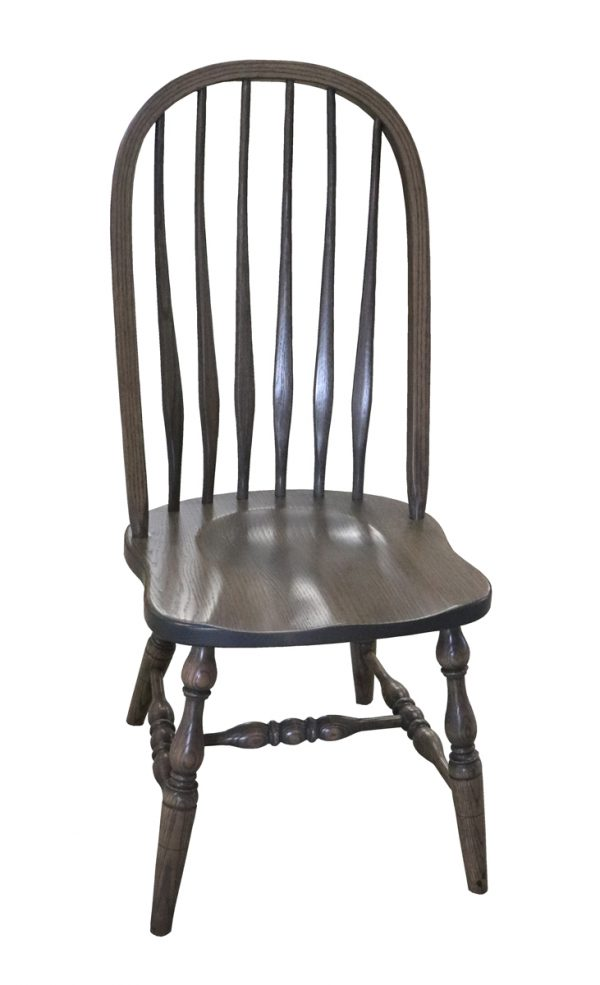 light stained wooden  bent back chairs